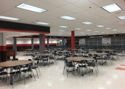 This is the cafeteria, still in the same place as always. Notable additions include booths along the outside wall (sacred ground for upperclassmen) as well as a pizza shop, snack bar, and other themed options.